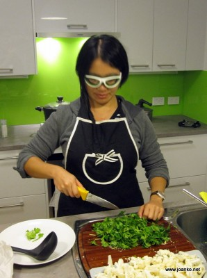Onion goggles in the kitchen (obviously posed, as I'm chopping parsley)